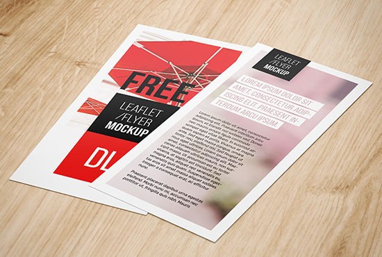 DL flyers lying on wood background