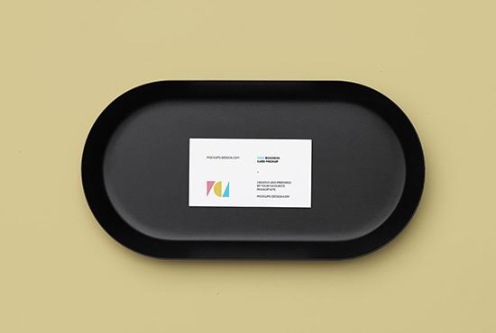 Business card on a black plate mockup